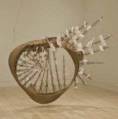 Tim Hawkinson's Möbius Ship sculptures are nautical, single-surfaced and have fractional dimensionality.