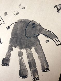 Elephant Hand Prints - turn your little ones hand & thumb prints in to a herd of elephants.  Easy, quick, fun, activities for pre-schoolers and toddlers.