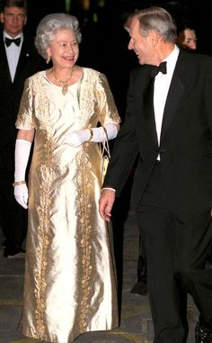 1997 from Queen Elizabeth II's Royal Style Through the Years  For her Golden Wedding Anniversary, the Queen opted—fittingly so—for a gold short-sleeve gown and white gloves.