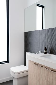 We're sharing our favorite penny tile bathroom backsplash ideas, from colorful to muted. Fair warning: One look and you might be tempted to makeover your own bathroom. Laundry In Bathroom, Bathroom Wall, Bathroom Interior, Modern Bathroom, Small Bathroom, Bathroom Ideas, Minimalist Bathroom, Bathroom Inspo, White Bathroom