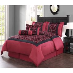 Spruce up any bedroom with this elegant seven piece comforter set in rich reds and blacks. The flocking pattern adds the perfect touch to this polyester set.