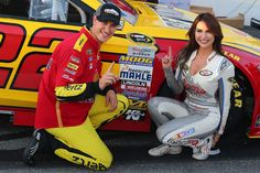 Joey Logano, #22 Shell Pennzoil Ford, poses with Miss Coors Light Amanda Mertz and the Coors Light Pole award after qualifying for the pole position for the NASCAR Sprint Cup Series Federated Auto Parts 400 at Richmond International Raceway.