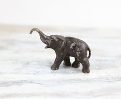 Primitive Cast Iron Miniature Elephant figurine rustic industrial Vintage toy paperweight collectible Jungalow style by LazyDayRelics on Etsy Vintage Wear, Vintage Toys, Bungalow Decor, Vintage Elephant, Elephant Figurines, Metal Casting, Rustic Industrial, Cast Iron, Primitive