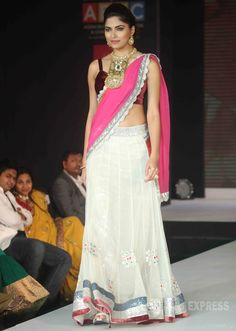 Former Miss India Parvathy Omanakuttan walked the ramp in a white lehenga teamed with maroon velvet choli and bright pink dupatta. (Photo: Varinder Chawla)