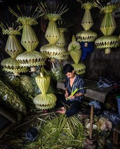 An artisan making janur kuning pernikahan in Jakarta the traditional decoration made from coconut leaves used in Indonesian weddings.