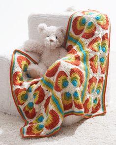 Free crochet pattern - Bright bold rainbow motifs in a mod baby blanket layout.