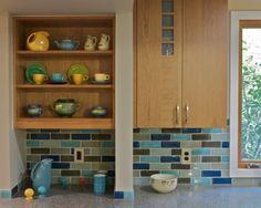 Shades of blue/aqua subway tile and Fiestaware.