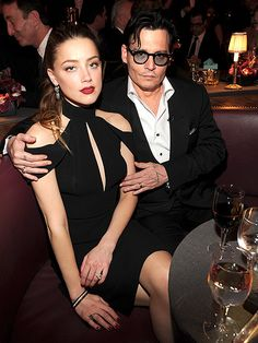 "Johnny Depp & Amber Heard's Reel-to-Real Romance | UP FOR GRABS | While the pair usually steers away from PDA, they just couldn't keep their hands off each other at a Spike TV event in May 2014. ""We all love who we love; we don't choose it,"" Heard told Net-A-Porter's The Edit."