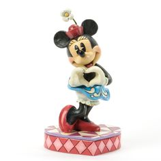 Jim Shore        Minnie (Love Symbol)     Minnie Mouse makes the universal signal of LOVE in this sweet sculpture designed by Jim Shore. Made of stone resin, and stands approximately    7in H x 3.25in W x 3.75in L $40.00