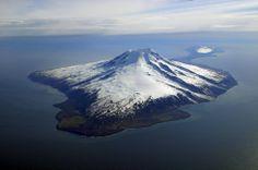 Jan Mayen - Norway. A remote island north of Iceland.