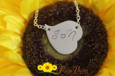 ❤ HEART NECKLACE DESCRIPTION: Personalized silver heart necklace by Pretty Prairie Designs. The heart is hand-stamped with a 2 monogrammed initials. This necklace makes a great gift or something you can cherish. #heartjewelry #lovenecklace #prettyprairiedesigns