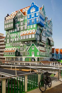 The Amsterdam Zaandam Inntel Hotel in the Netherlands is so colorful & it looks just like a jigsaw puzzle! This design takes inspiration from historic Dutch architecture - add it to your travel journal!