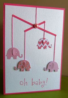 The mobile on this handmade baby card is so cute - and would be easy to customize for your new baby - use any dangling objects you would like along with simple slender paper cuts for the mobile - genius!