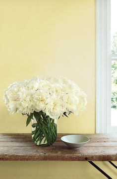 A bouquet of double peonies capture the softness of Ralph Lauren Paint's sweet pale yellow, Port Grace