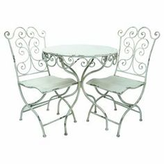 """Scrolling metal bistro set with a table and 2 chairs.   Product: 2 Chairs and 1 bistro tableConstruction Material: MetalColor: Distressed whiteDimensions: Bistro Table: 29.75"""" H x 27.5"""" Diameter Chair: 35"""" H x 16"""" W x 16.5"""" D Note: Assembly required"""