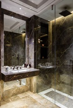 Private Apartment Belgravia | The girls bathroom has Fior di Bosco flooring with a Calacatta marble border and underfloor heating plus a step-free rain shower with recessed lighting and downlighting below the sink.