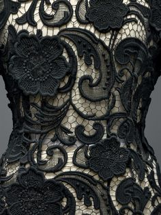 Prada (Italian, founded 1913), Miuccia Prada (Italian, born 1949). Dress (detail), autumn/winter 2008–9, Prêt–à–Porter. Machine–sewn black cotton guipure lace with hand–applique of black cotton guipure (detail, opposite). Photo © Nicholas Alan Cope. #ManusxMachina #CostumeInstitute