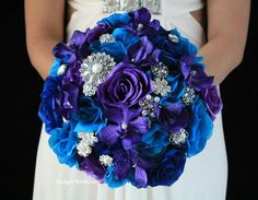 Purple, turquoise and blue wedding flowers with tons of bling.  Complete 5 piece package only $300