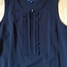 GAP dress in black Worn once (maybe?) great front detail with side zip. Poly/rayon/spandex blend. Machine washable. GAP Dresses
