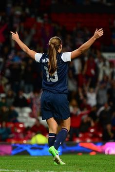 Alex Morgan celebrates after scoring the winning goal in extra time against Canada in the semi finals at Old Trafford.