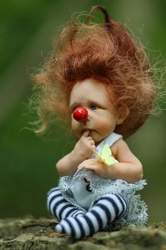 lil' clown, so cute you have to smile