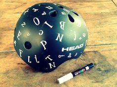 Alphabet painted bikers helmet. So simple it doesn't need a DIY;)