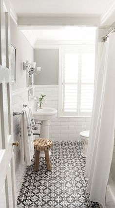 love the patterned floor tile and white subway tile on the walls, plus the interesting bench - would paint the upper walls a slightly darker shade