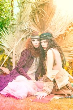 Two gypsy girls with curly hair and headbands