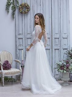 Le dos nu dentelle - Mariage : 10 robes de mariée d'hiver repérées sur Pinterest - Photos Mode - Be.com