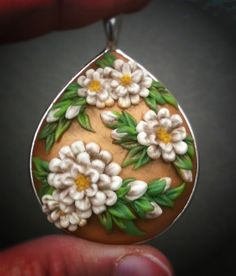 Floral pendant - gold and off-white by jainnie.jenkins, via Flickr