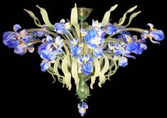 Plafoniera Iris Azzurri prodotto in vetro di Murano presso la Vetreria Artistica Busato Glasses. Contattaci per maggiori informazioni.