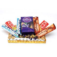 In this hamper, you will get different types of chocolates like 2 Bounty Chocolate , 2 Galaxy Hazelnut, 2 Kit kat, 10 Eclairs and one Cadbury Celebration. In addition, the chocolates come in a nicely decorated tray, which can also be used for othe purpose. Let your dear ones in India savor in the delicious taste of the chocolates which you can send through Giftblooms.com. Apart from these chocolates, you will be to send other Gifts to India as well.