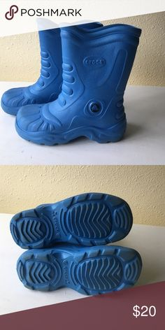 Crocs XS W 4-5 blue Rain boots Very good condition blue crocs rain boots. These are a size 4-5 w and they fit my son when he was in a size 3 Youth. CROCS Shoes Boots