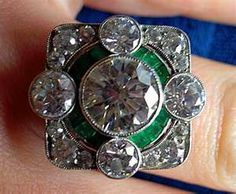 This antique diamond & emerald ring is lovely.
