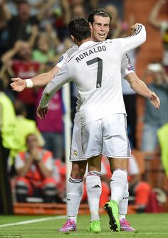 Cristiano Ronaldo and Gareth Bale celebrate after Real Madrid score twice in as many minut...