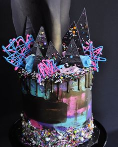 Funky, techno cake for a boy's laser tag birthday party. The chocolate sail on…