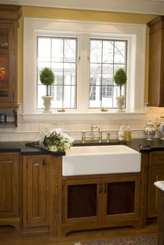 I will have a farmhouse sink when I own my own home.  I would love to have such a big window above it too! Gorgeous.