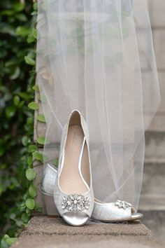 Silver wedge heels accented with brooches. The ideal wedding shoes for the bride who wants comfort and glam! {Monique Hessler Photography}