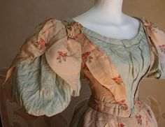 Mid-1890s evening gown in silk, bodice laces up in back. Interesting sleeve construction.