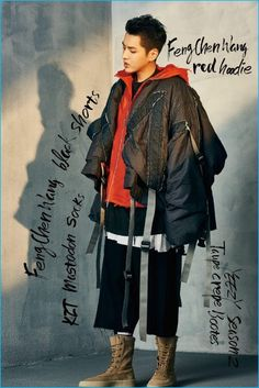 Championing adventurous layers, Kris Wu dons the latest from Feng Chen Wang for YOHO! magazine.