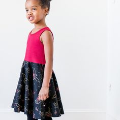 Watch out! Fierce, beautiful dragons circle this print, breathing fire of scarlet and sparkling gold. Your awesome girl will always be in control of these beasts, commanding them to fly - wings outspread - with every twirl of her skirt. With pockets for storing treasures and a deep red top, this dress is sure to be a favorite of your Little Dragon Tamer.  Sizes 2T, 3T, 4T, 5, 6, 7, 8, 10, 12.