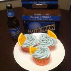 Blue Moon cupcakes. I made the cake by the recipe on the link, but I made my own homemade frosting (cream cheese with orange zest) and tinted it a gray blue with food coloring to match the Blue Moon color scheme.