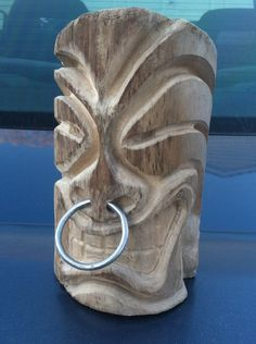 Hand carved tiki head decoration. via Etsy.