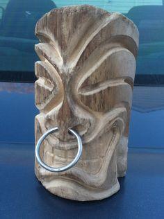Hand carved tiki head decoration. via Etsy.