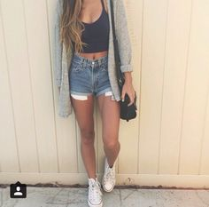Dark blue jean shorts, black crop top, grey knit cardigan and white converse