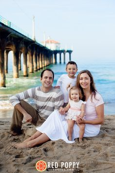 family beach photo with pier