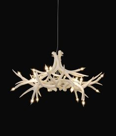 Antler Chandelier--these are not real.  Need to make a real antler chandelier just like this one for Alexi and Bill's wedding.