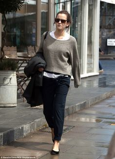 Off-duty: Emma Watson wore heavy layers on Tuesday as she visited a coffee shop in London...