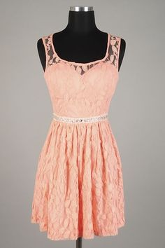 Are you feeling feminine and pretty? Then you are in need of this peach lace dress with keyhole back. A beaded sewn sparkly in belt at the waist is sure to accentuate your best features. Put on your cute flats with the bows on the toe and take on the town in this dress