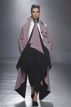 Bathed in the yellow light of ancient projectors and swathed in artificial smog, the Aganovich runway set the tone for a collection where perception and obsession blurred into a gradient.  ...
